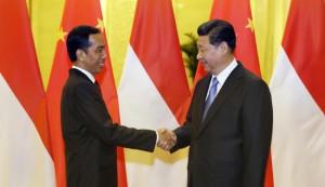 Presiden Indonesia Joko Widodo menghadiri pertemuan dengan Presiden China Xi Jinping (REUTERS)